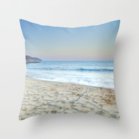 Blue waves at sunset Throw Pillow by Guido Montañés