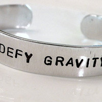 Stamped Wicked Witch Cuff Elphaba Defy Gravity by Serenitystorms