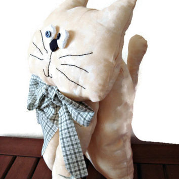 Sweet patchwork stuffed beige cat with a green tie.