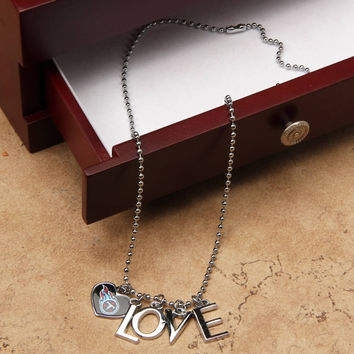 Touch by Alyssa Milano Tennessee Titans Ladies Love Necklace with Heart Team Logo - http://www.shareasale.com/m-pr.cfm?merchantID=7124&userID=1042934&productID=528441247 / Tennessee Titans