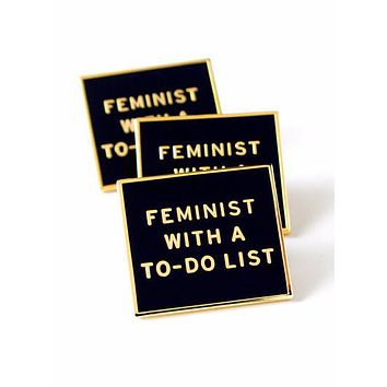 Feminist With a To-Do List Enamel Pin in Black and Gold