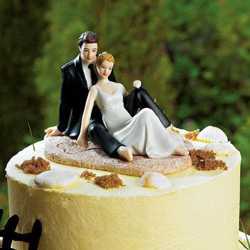 Romantic Wedding Couple Lounging on the Beach Figurine (Pack of 1)