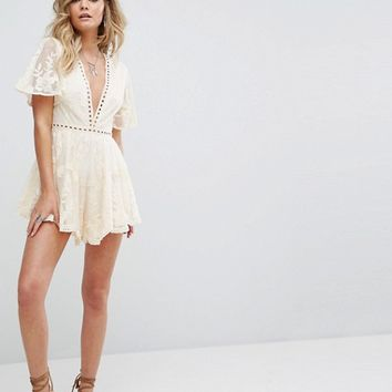 Kiss The Sky Festival Lace Romper With Ladder Detail at asos.com