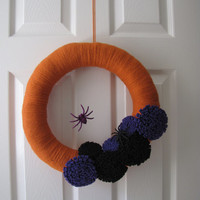 Halloween Yarn Wreath with purple and black felt flowers and spiders