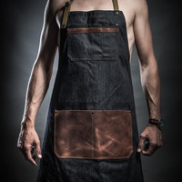 Denim apron with cowhide leather pockets and Upcycled military belts