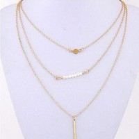 Delicately Layered Pearl and Gold Triple Chain Necklace