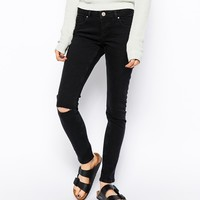 ASOS Whitby Low Rise Skinny Jeans in Washed Black With Ripped Knee