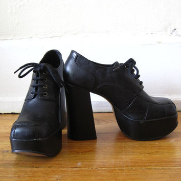 vintage 90s does 70s Wild Pair black leather platform shoes lace up club kid goth