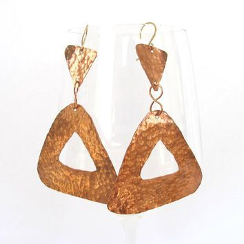 Long triangle earrings handmade from hammered copper