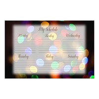 Multicolored Christmas lights. Lined schedule. Stationery