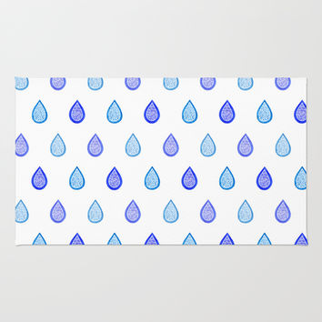 Blue raindrops Rug by Savousepate