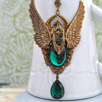 THE FALLEN antiqued brass dark angel necklace with emerald green color vintage glass cab and jewel