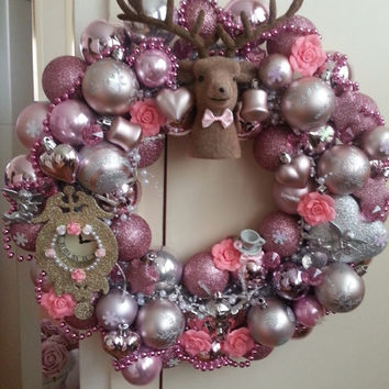 Shabby chic pink christmas wreath with lights and lots of ornaments raindear theme