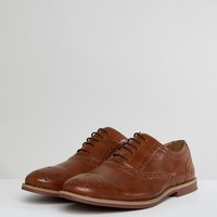 ASOS Brogue Shoes In Tan Faux Leather With Contrast Sole at asos.com