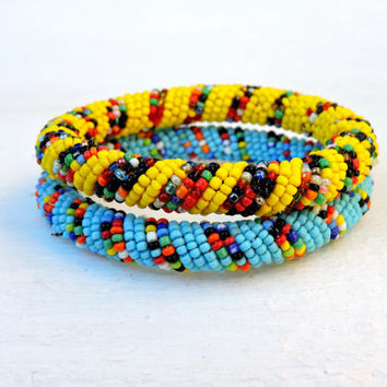 2 African bangles (blue and yellow spiral bracelet) (African, traditional tribal, bangle / bracelet)