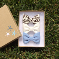 Cheetah, off white, and blue chambray hair bows from Seaside Sparrow.  Seaside Sparrow bows make the perfect birthday gift.
