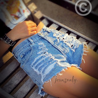 Vintage high waisted distressed denim shorts by Jeansonly