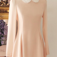 Pink long sleeved winter dress with white ruffle peter pan collar