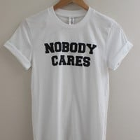 Nobody Cares White Graphic Top