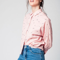Pink blouse printed with black butterflies and dots