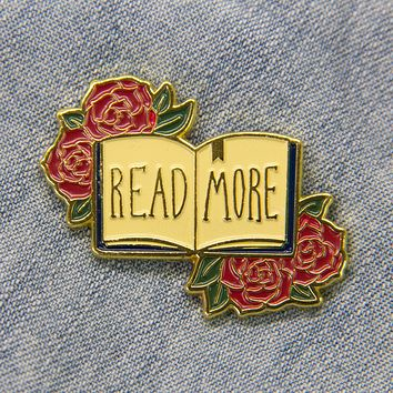 """Read More"" Gold Enamel Pin of a Book and Roses"
