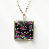 Pendant charm with glass and chain. Flower print. Purple flowers.