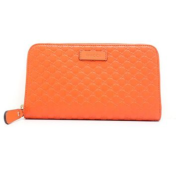 Gucci Sun Orange Leather Microguccissima GG Zip Around Wallet 449391
