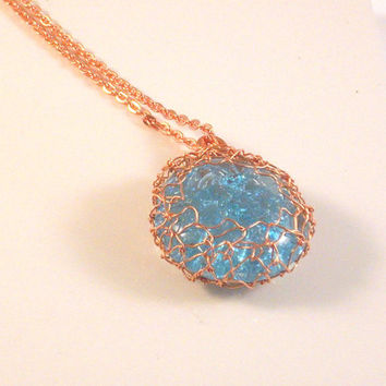 "SUN KISSED - Light Blue Fractured Pendant Woven Together With 2 Copper  Wires, Suspended from a 20"" Copper Chain."