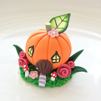 Miniature pumpkin fairy house cake topper hand made from polymer clay