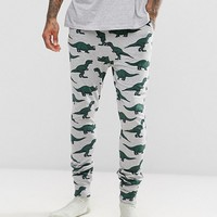 ASOS Pajama Bottoms With Branded Waistband & Dinosaur Print at asos.com