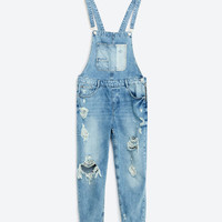 SLIM DENIM DUNGAREES WITH RIPS DETAILS