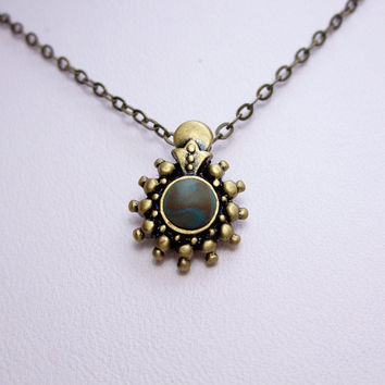 Sunny golden pendant with a smoky center by AndreaBacmanJewelry