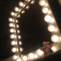 Makeup artist lighted vanity makeup mirror called Rock Star. Includes 24 white satin G50 bulbs,dimmer, wall mount.Choose the color of frame!