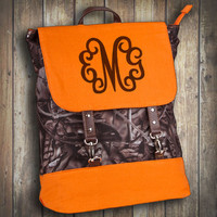 Monogrammed Mossy Oak Camo Backpack with Orange Trim  Font shown MASTER CIRCLE in brown