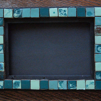 wood frame with ceramic mosaik