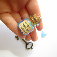 "Disney's Alice in Wonderland ""Drink Me"" mini bottle pendant necklace/ VIAL necklace with blue glitter/ galaxy/ cosmos/ unicorn/ magic"