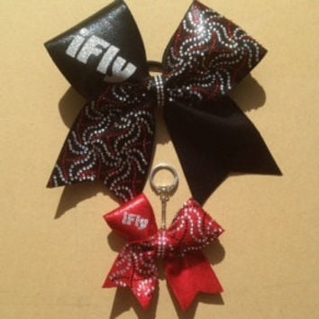 I fly,I back, I spot, I base, I tumble, etc. Fabric covered Cheer bow with silver rhine studs and crystal and matching key chain bow.