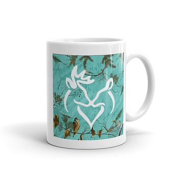 Snuggling Buck and Doe On Aqua Camo Mug