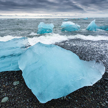 Cool Blue Glacier Ice On Black Beach In Iceland