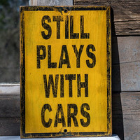 Still Plays With Cars sign yellow black old rustic aged distress home decor shop car garage car collector gas monkey car enthusiast gift