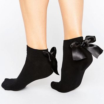 ASOS Oversized Bow Back Trainer Sock at asos.com
