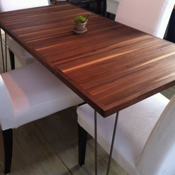 Walnut dining table, mid century modern inspired featuring hairpin legs.