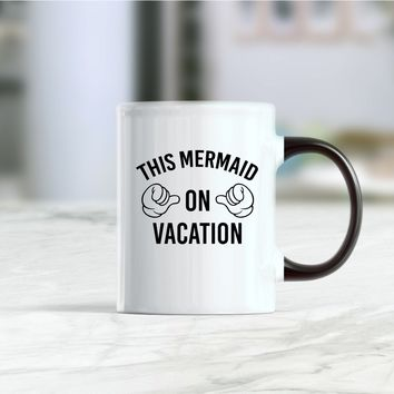 This mermaid on vacation coffee mug