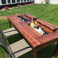Solid outdoor table with hidden cooler built in center