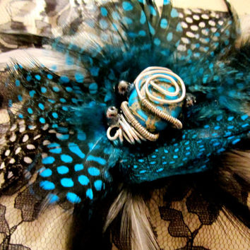 Feather Fascinator with Black and Blue Flower and by FeatherFunded