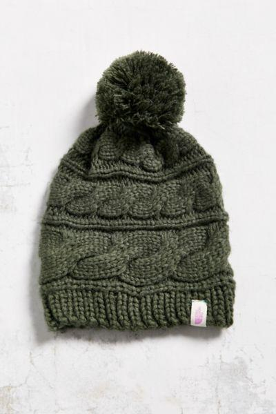 fba3bfadba0 The North Face Triple Cable Pompom Beanie from Urban Outfitters