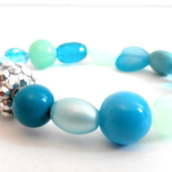 Blue Stretchy Glass and Acrylic Beaded Bracelet with a Mixture of Shapes, Sizes and Hues of Blue