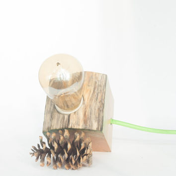Small and simple wood lamp made out driftwood found on the shores of Baltic sea with green wax finishing to bring out the wood texture
