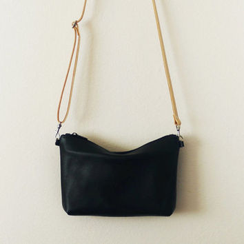 Black leather crossbody bag with vegetable tanned leather strap