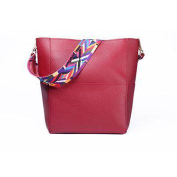 Women's Large Soft PU Leather Crossbody Bucket Bag With Colorful Woven Shoulder Strap